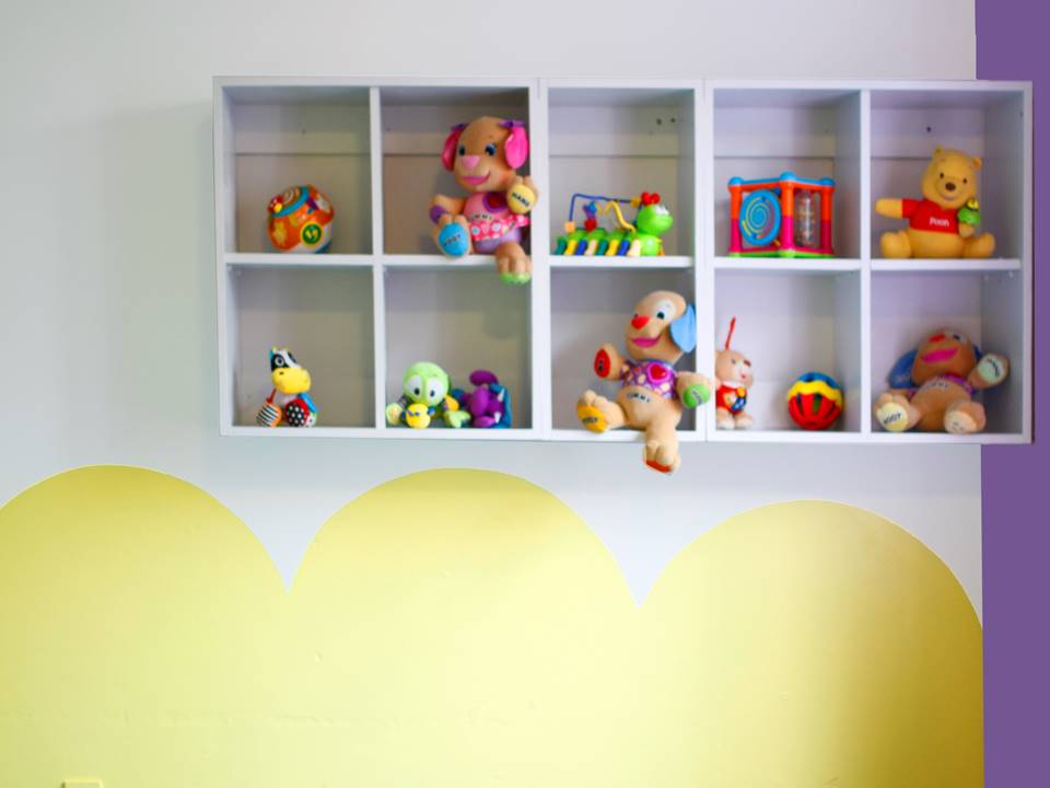 Restless Design Creche yellow wall purple wall shelves interiors toy fun interiors