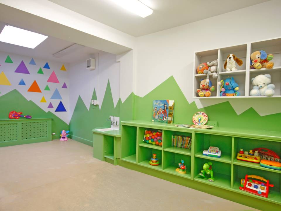 Restless Design cool playroom colours in interiors colour blocking vibrant interior green playroom creche toys